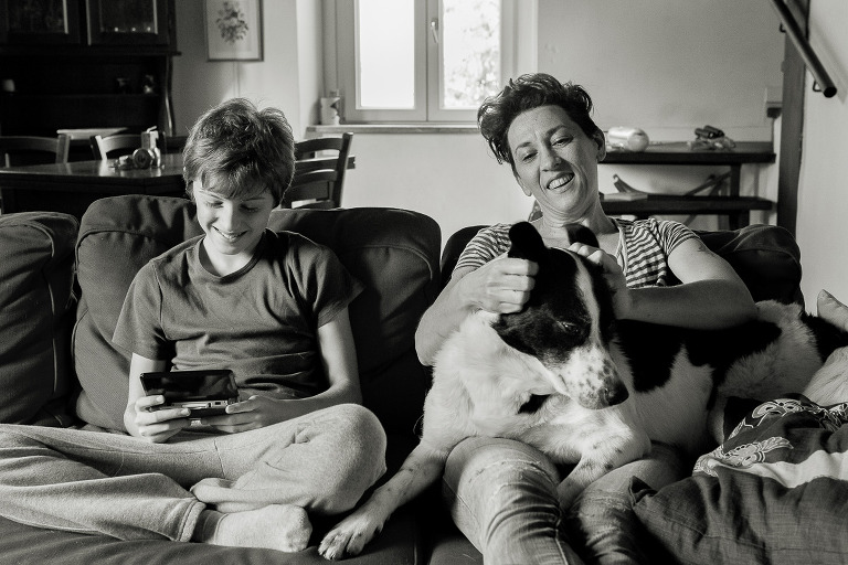 mother with son on the sofa with a dog