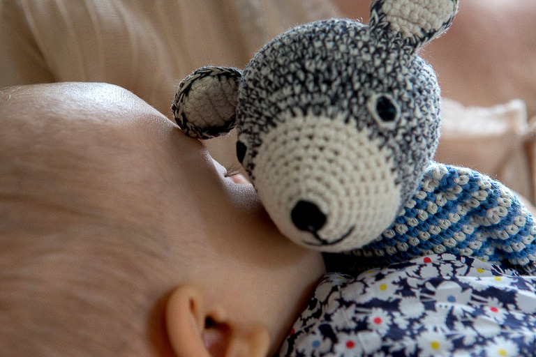 baby is sleeping with a bunny