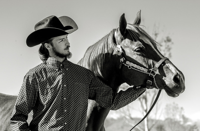 young man is looking proudly on his horse
