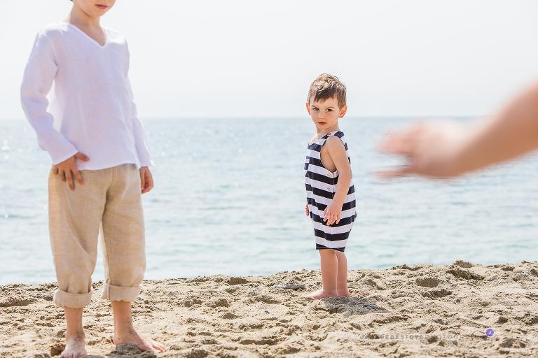 boy siblings on the beach