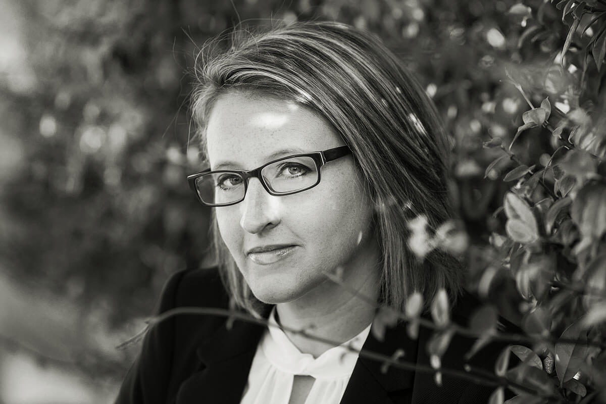 emotional portrait of blond woman with glasses
