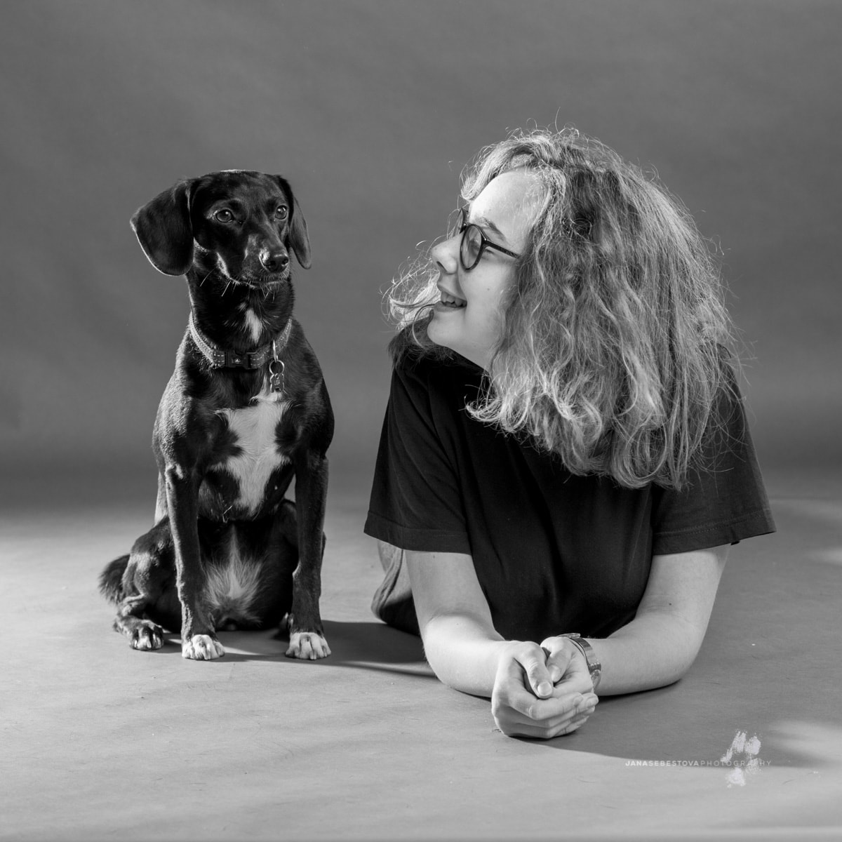 teen girl with her dog in studio shoot