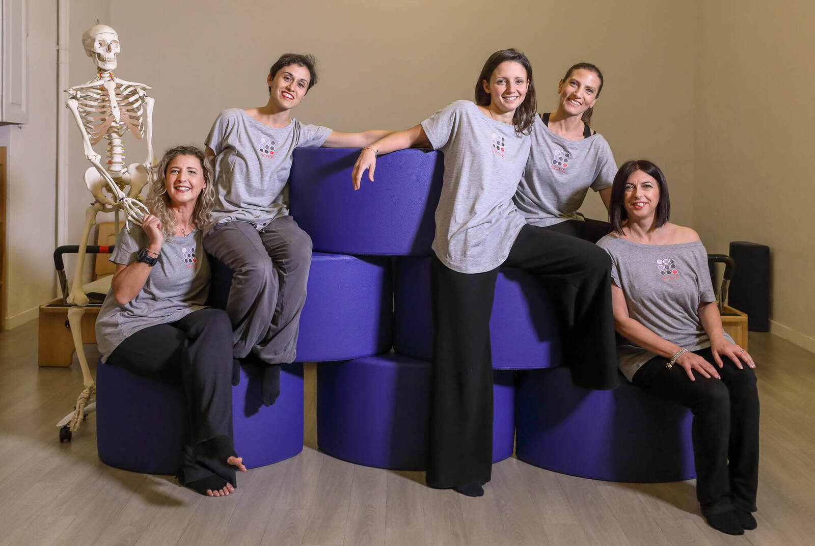 group portrait of pilates trainers